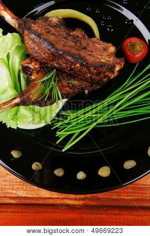 main course: barbecued ribs served with capers and chives