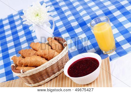 Continental breakfast with croisant and orane juice