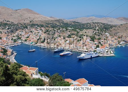 SYMI, GREECE - JUNE 19: Looking down onto boats moored in Yialos harbour on June 19, 2011 on Symi island, Greece. Yialos is a popular destination for day trippers from Rhodes island.