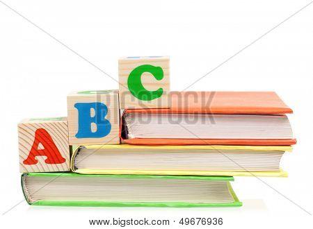 Alphabet letter ABC blocks for kids on books isolated on white background