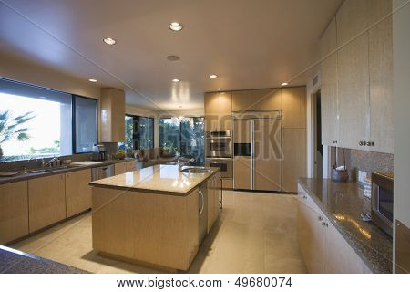 View of a spacious kitchen with island in house