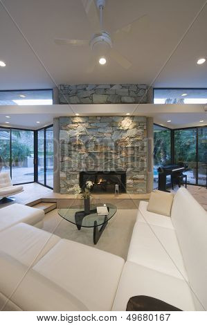 Sunken seating area and stone fireplace at modern home