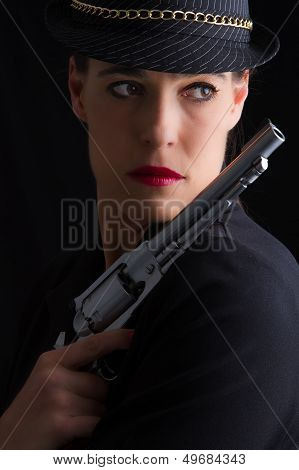 Dangerous Woman In Black With Silver Handgun