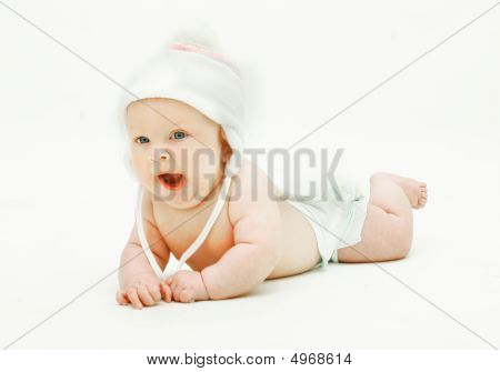 Yawning Baby In Hat Over White