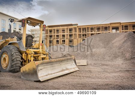Industrial bulldozer on construction site with space for text.