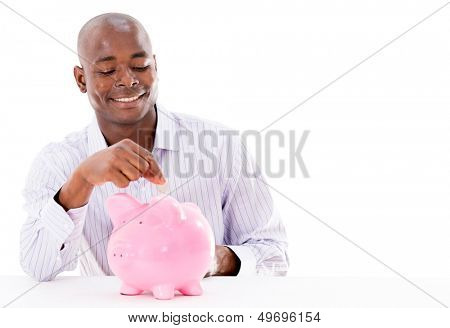 Happy man saving money in a piggybank - isolated over white