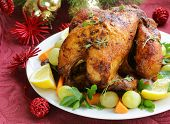 stock photo of christmas meal  - baked chicken for Christmas dinner - JPG