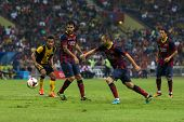 KUALA LUMPUR - AUGUST 10: FC Barcelona's Andres Iniesta (blue boots) dribbles the ball in a friendly
