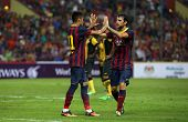 KUALA LUMPUR - AUGUST 10: Barcelona's Neymar (left) and Cesc Fabregas celebrate a goal scored agains