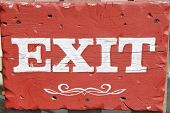Exit sign on wood
