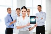 business, communication and internet concept - businesswoman holding tablet pc with email sign