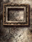 artistic background with empty frame over silver wall