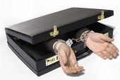 stock photo of white collar crime  - A Hand appears reaches out of a briefcase - JPG