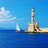 pictorial scene in Chania with light house and yacht