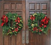 image of christmas wreaths  - Christmas wreaths hanging on church doors in Round Rock TX - JPG