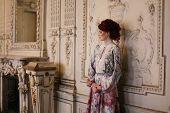 pic of edwardian  - Young beautiful woman standing in the palace room - JPG
