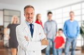 stock photo of surgeons  - Portrait of a smiling family doctor - JPG