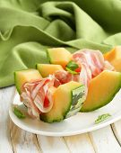 stock photo of smoked ham  - Italian antipasti melon with smoked ham  - JPG