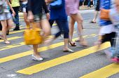 picture of pedestrians  - crosswalk and pedestrian at street in hong kong - JPG