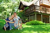 picture of house woods  - a young attractive happy family of four - JPG