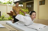 image of thai massage  - Woman getting Thai massage from professional masseuse - JPG