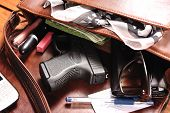 stock photo of handgun  - Handgun and accessories falling from a woman - JPG