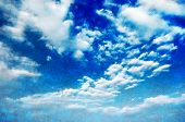 stock photo of puffy  - Blue sky with white puffy clouds - JPG