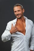 stock photo of open shirt breast showing  - white shirt on a manly man isolated - JPG