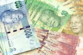 stock photo of nelson mandela  - South African new bank notes in piles, finances