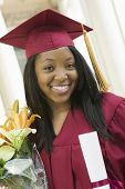 picture of convocation  - Portrait of happy female student with certificate and flower bouquet on graduation day - JPG