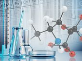 pic of beaker  - Laboratory glassware on color background - JPG