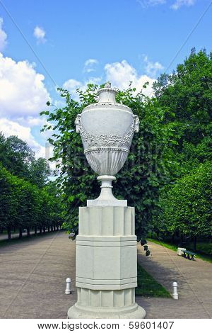 Antique Marble Amphora On A Stone Pedestal In The Park