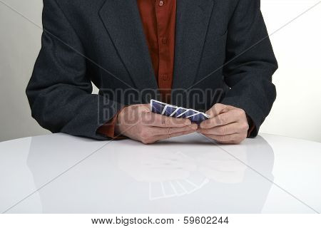 Man In Suit Playing Poker