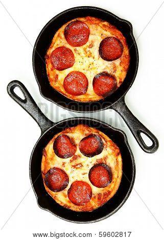 Two Single Serve Skillet Peperonni Pizzas Over White