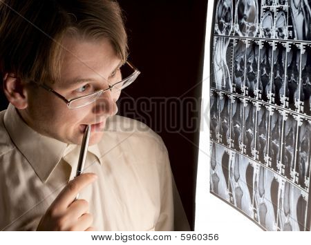 Puzzled Radiologist Looking At Mri