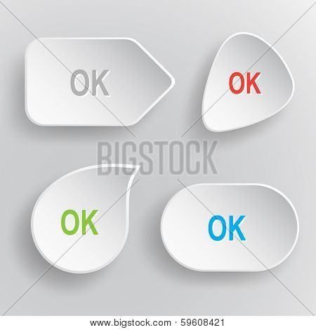 Ok. White flat vector buttons on gray background.