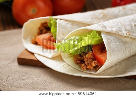 Burritos With Beef Tomato And Salad Leaf
