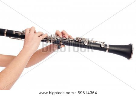 hands playing clarinet on a white background