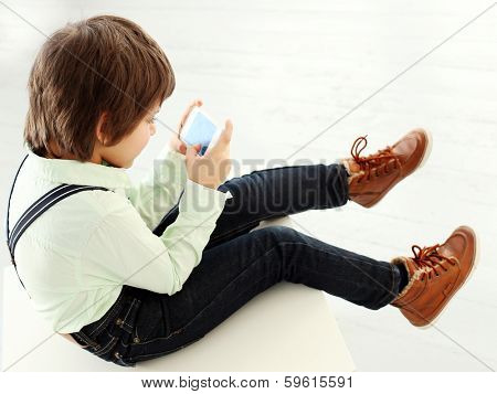 Adorable, cute kid with mobile