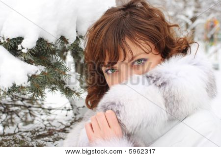 Beautiful woman in the fur coat