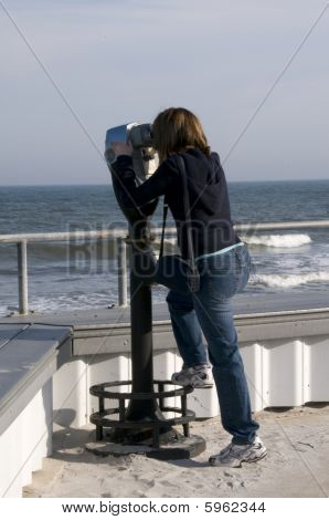 Tourist Viewing The Ocean