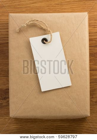 parcel wrapped packaged box on wooden background