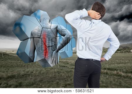 Thinking businessman scratching head against stormy countryside background