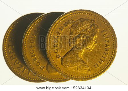 Three one pound coins