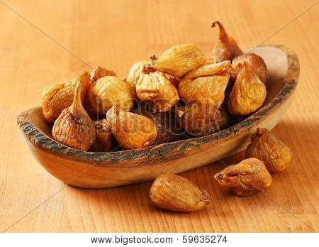 dried figs served on a wooden tray