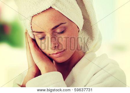 Portrait of 20-25 years old beautiful woman wearing bathrobe