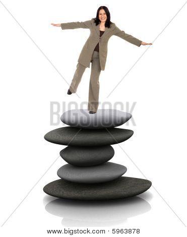 Business Woman Balancing Over Stones