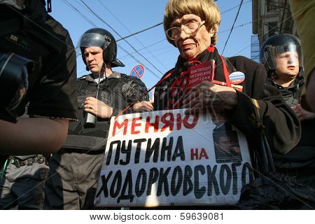 MOSCOW - MAY 31, 2011: During a prohibited rally to support the 31st article of the Russian Constitution that gives right to peaceful assemblies. Inscription on banner: