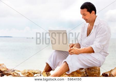 Beach Man With A Laptop