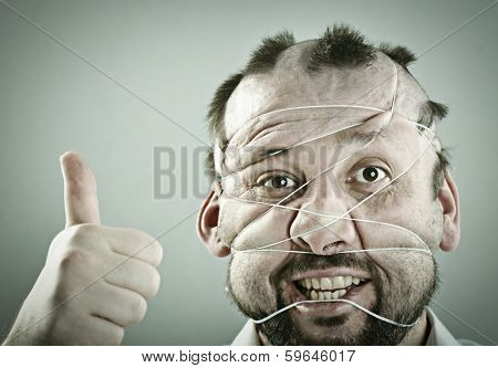 Man portrait with thumb up